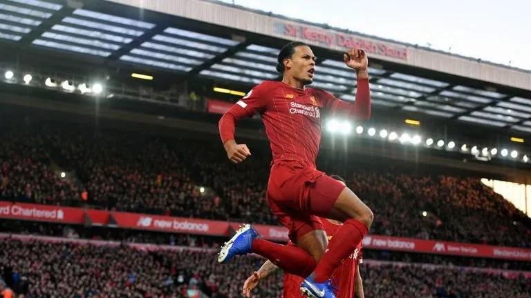 Virgil van Dijk celebrates scoring his first goal against Brighton