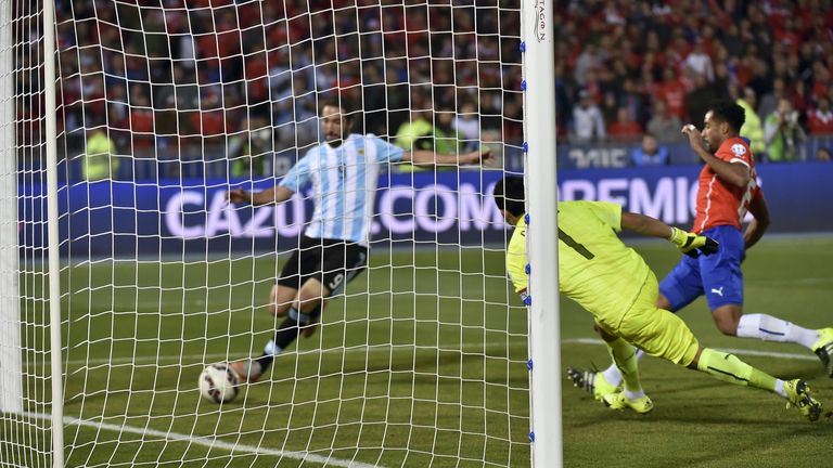 Argentina's Gonzalo Higuain misses a clear chance in injury time