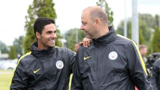 Mikel Arteta (left) is now on the coaching staff at Manchester City