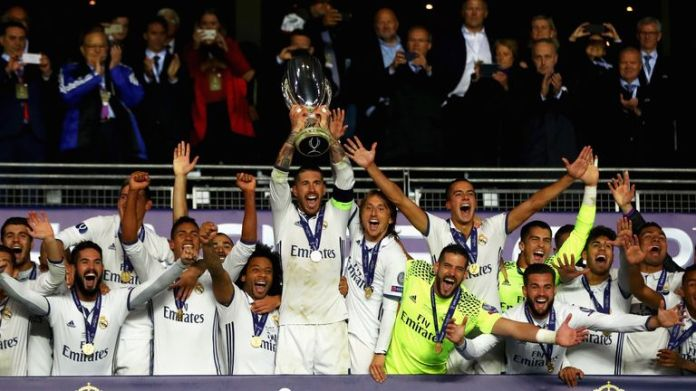 Sergio Ramos lifts the trophy after his Real Madrid's victory in the UEFA Super Cup final