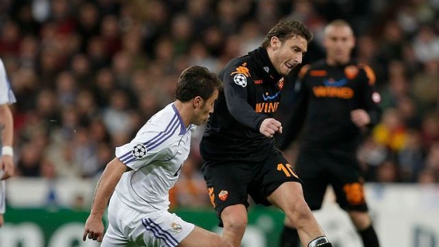 Cannavaro (L) of Real Madrid tackles Francesco Totti of Roma