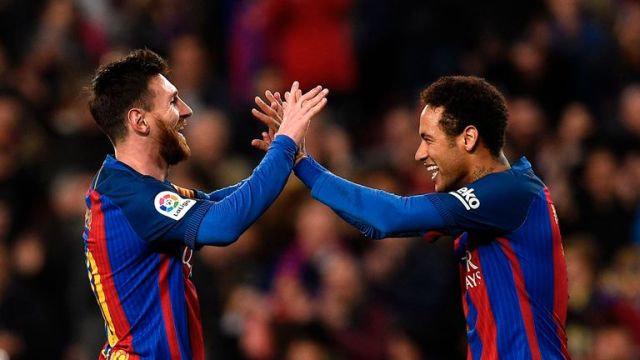 Barcelona's Lionel Messi celebrates with Neymar
