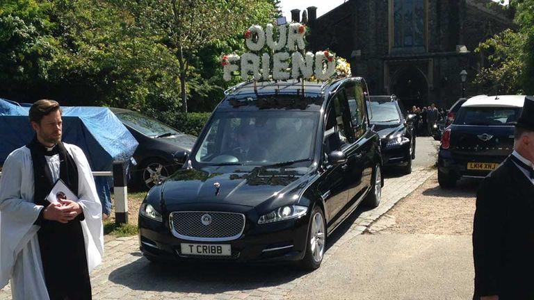 Ugo Ehiogu's hearse leaves the church in Highgate, London