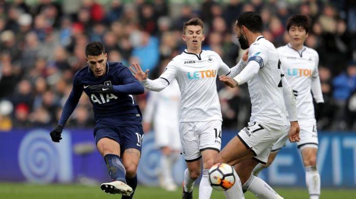 Erik Lamela curled home Tottenham's second against Swansea