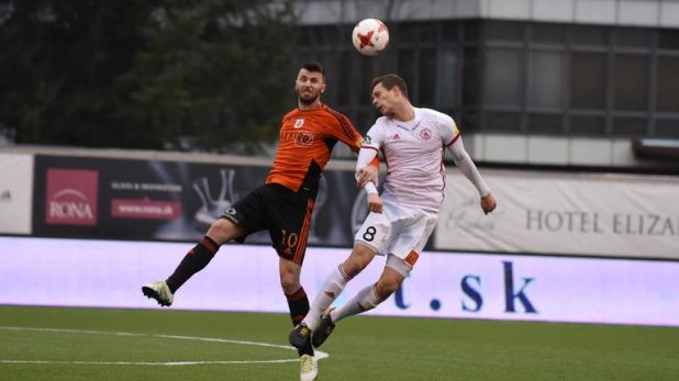 Lawrence competes for a header while playing for AS Trencin  [Credit: AS Trencin]