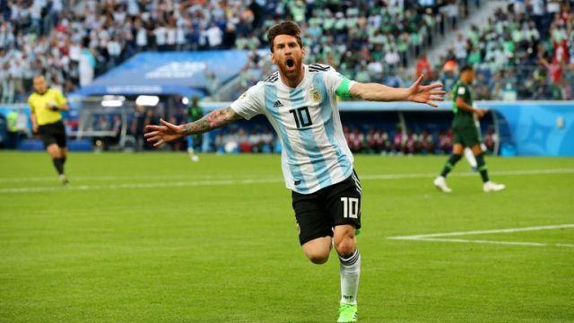 Lionel Messi celebrates after scoring Argentina's first goal against Nigeria