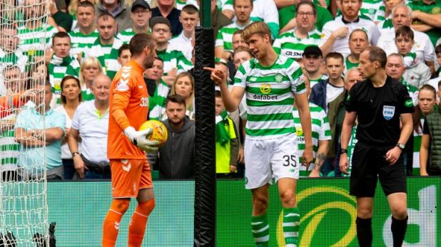 Celtic's Kristoffer Ajer (right) exchanges words with Rangers' Allan McGregor