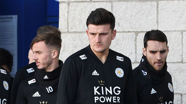 James Maddison and Harry Maguire look at the bloody tributes left for the victims of the helicopter crash outside King Power Stadium