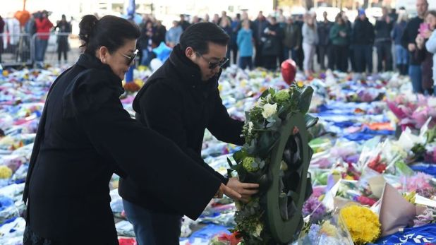 Aiyawatt and Aimon, son and wife of Leicester City owner Vichai Srivaddhanaprabha, pay their respects and lay a floral tribute outside the club's King Power Stadium