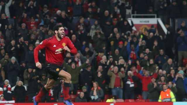 Marouane Fellaini celebrates his last-gasp winner to send Man Utd into the last 16