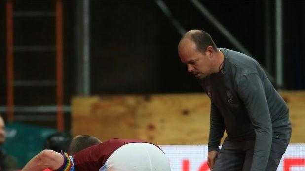 Joe Gomez lies injured on the touchline at Turf Moor