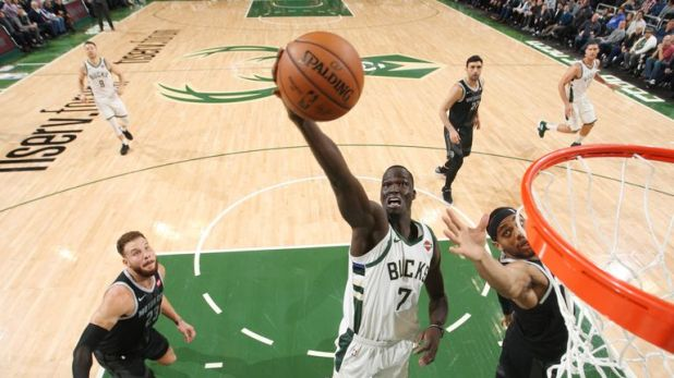 MILWAUKEE, WI - DECEMBER 5:  Thon Maker #7 of the Milwaukee Bucks shoots the ball against the Detroit Pistons on December 5, 2018 at the Fiserv Forum Center in Milwaukee, Wisconsin. NOTE TO USER: User expressly acknowledges and agrees that, by downloading and or using this Photograph, user is consenting to the terms and conditions of the Getty Images License Agreement. Mandatory Copyright Notice: Copyright 2018 NBAE (Photo by Gary Dineen/NBAE via Getty Images).