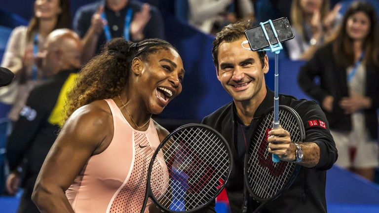 Serena Williams and Roger Federer pose for a selfie following their mixed-doubles match at the Hopman Cup