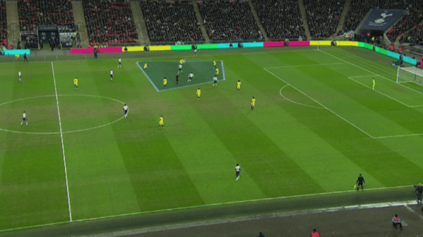 Harry Kane managed to score after being surrounded by Chelsea players
