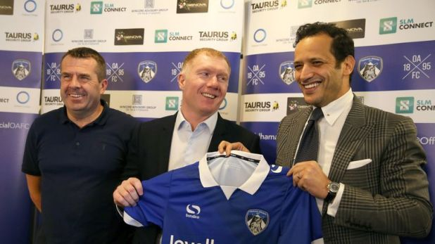 Scholes was unveiled alongside owner Abdallah Lemsagam (right) and assistant Mick Priest