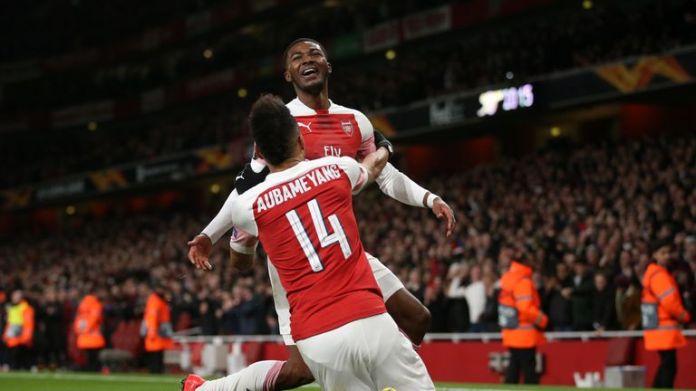 Ainsley Maitland-Niles celebrates against Rennes with Aubameyang