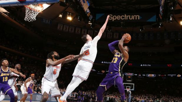 Mario Hezonja #8 of the New York Knicks blocks the shot against LeBron James #23 of the Los Angeles Lakers during the game on March 17, 2019 at Madison Square Garden in New York City, New York.