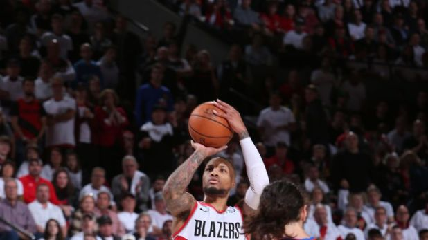 Damian Lillard shoots a three-pointer in Portland's Game 5 clash with Oklahoma City