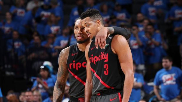Damian Lillard #0 and CJ McCollum #3 of the Portland Trail Blazers look on during Game Four of Round One of the 2019 NBA Playoffs on April 21, 2019 at Chesapeake Energy Arena in Oklahoma City, Oklahoma.