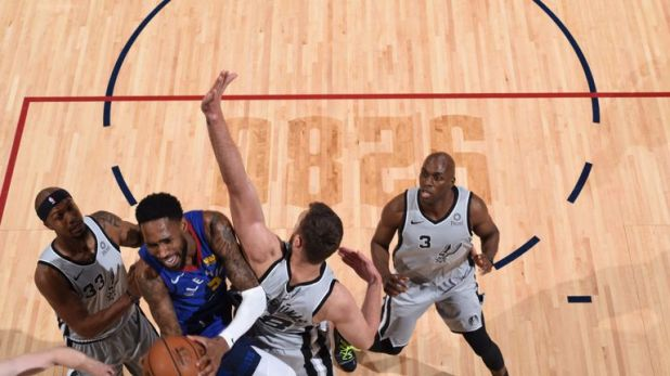 Will Barton absorbs contact while attacking the basket against San Antonio