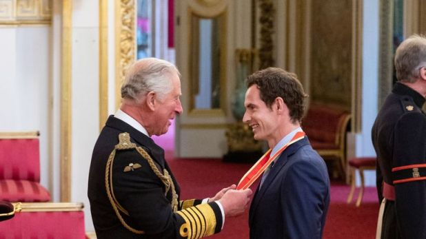 Andy Murray receives his knighthood from Prince Charles at Buckingham Palace