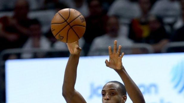 Khris Middleton lofts a pass during Milwaukee's Game 1 win over Toronto