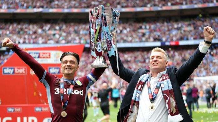 Jack Grealish and Dean Smith celebrate winning promotion