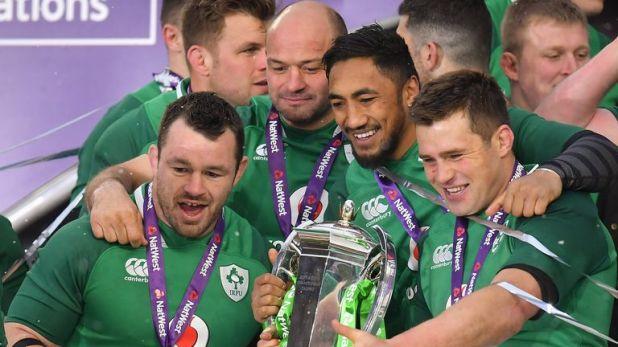 Healy celebrates with team-mates following Ireland's 2018 Six Nations Grand Slam