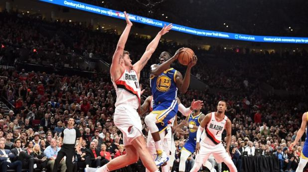 Draymond Green #23 of the Golden State Warriors drives to the basket against Meyers Leonard #11 of the Portland Trail Blazers in game three of the NBA Western Conference Finals at Moda Center on May 18, 2019 in Portland, Oregon.
