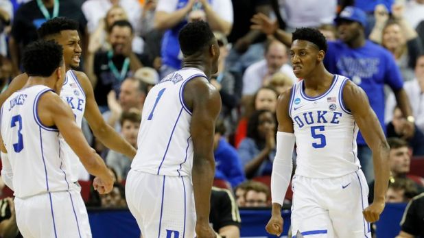 Zion Williamson #1 of the Duke Blue Devils celebrates with RJ Barrett #5 and Tre Jones #3 against the UCF Knights during the first half in the second round game of the 2019 NCAA Men's Basketball Tournament at Colonial Life Arena on March 24, 2019 in Columbia, South Carolina.