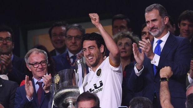Valencia captain Dani Parejo lifts the Copa del Rey after his side's 2-1 win over Barca