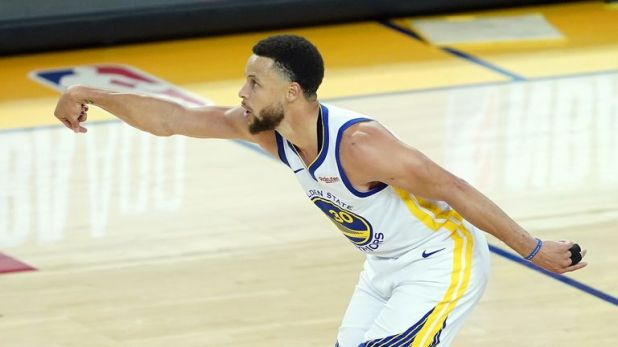 Stephen Curry celebrates a basket during Golden State's Game 1 win over the Portland