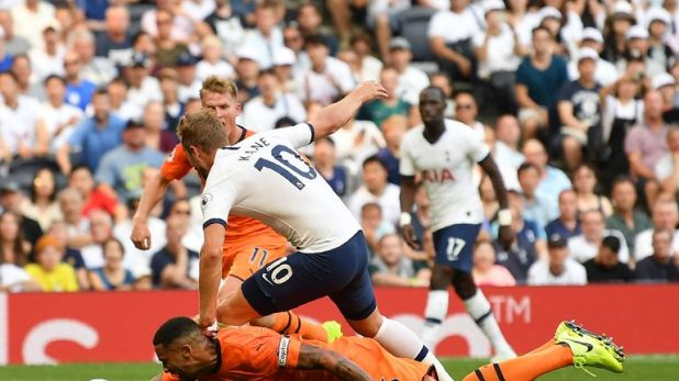 Harry Kane goes down in the penalty area under the challenge of Jamaal Lascelles, but VAR said no penalty