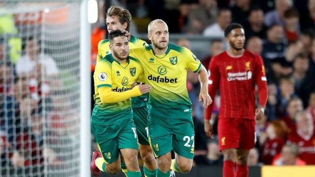 Teemu Pukki (right) celebrates scoring Norwich's goal