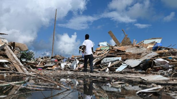 A man salvages debris in Marsh Harbour, Abaco Islands in the Bahamas, one week after Hurricane Dorian hit