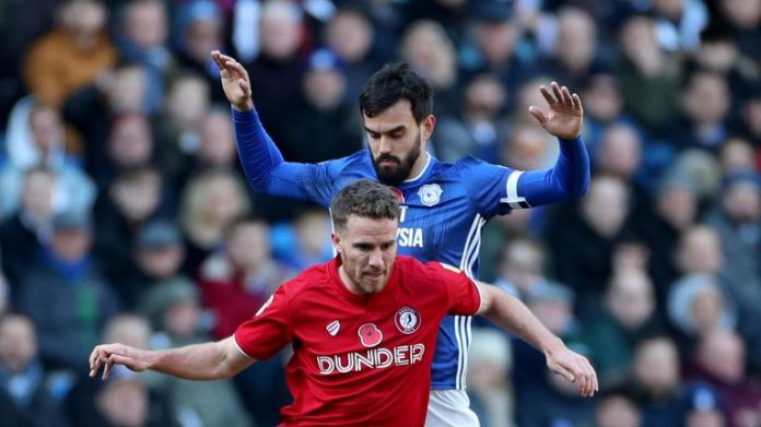 Bristol City's Marley Watkins (left) in action with Cardiff's Marlon Pack