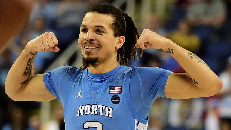 Cole Anthony flexes in celebration during a North Carolina game