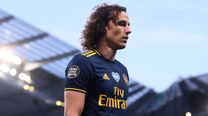 Arsenal's David Luiz walks off after being sent off against Manchester City