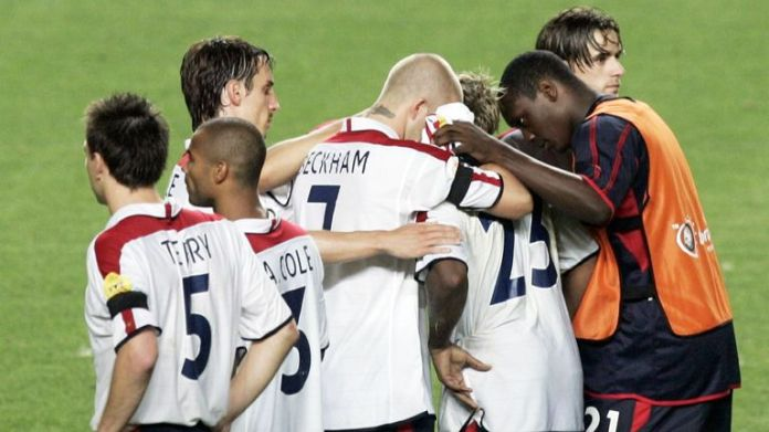 England players console team-mate Vassell after missing the decisive penalty
