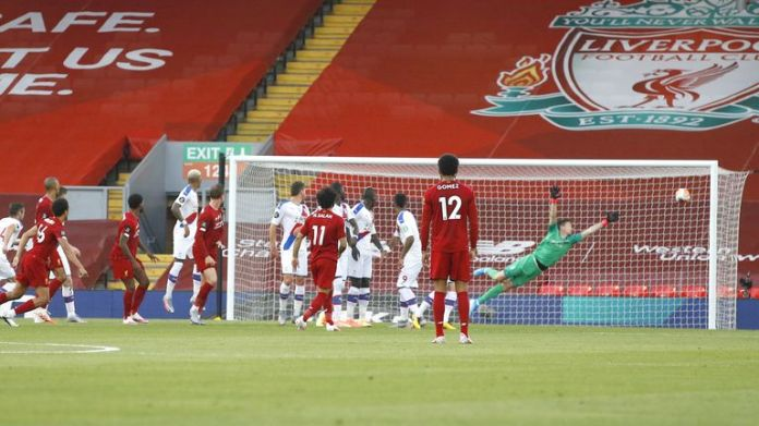 Trent Alexander-Arnold scores a free-kick against Crystal Palace