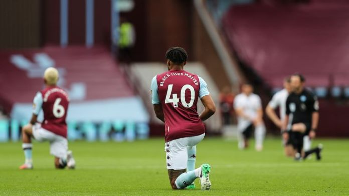 All 22 players and match officials took a knee for the first 10 seconds of the match at Villa Park