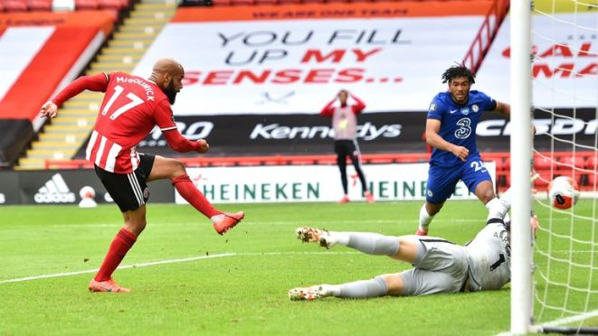David McGoldrick scores Sheffield United's first goal against Chelsea