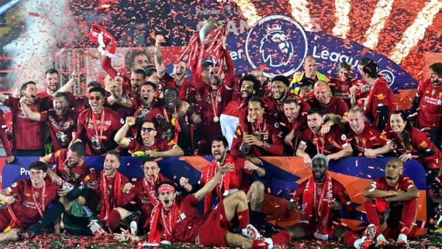 Liverpool players celebrate with the Premier League trophy