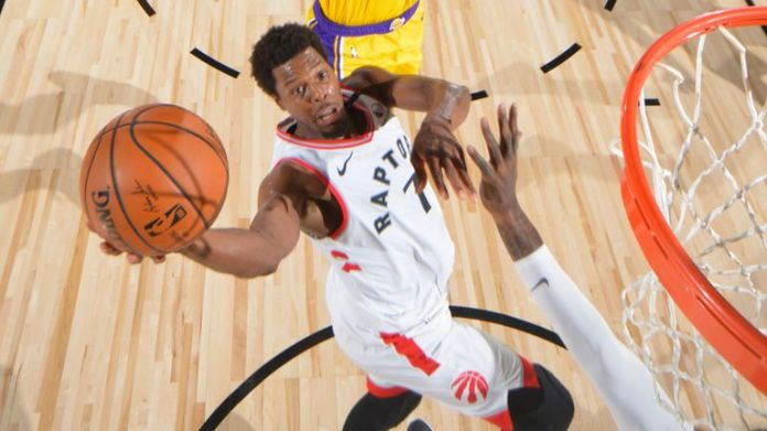 Kyle Lowry attacks the basket against the Lakers