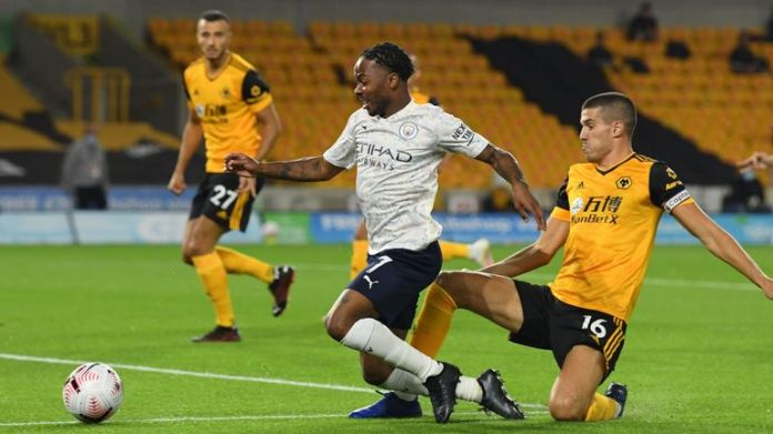 Raheem Sterling goes down under a challenge from Conor Coady