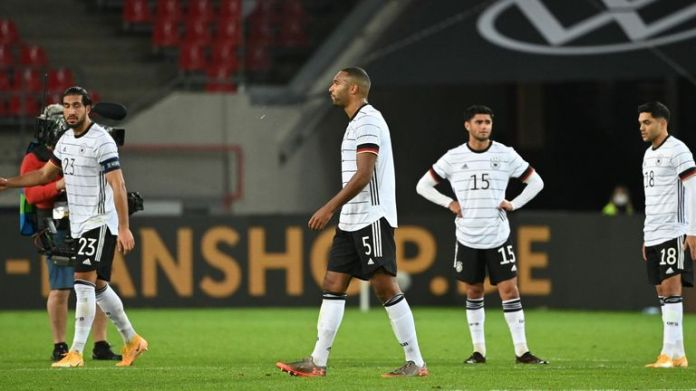 German players look dejected after spectacular 3-3 draw with Turkey