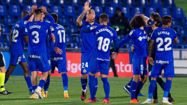 The Getafe players celebrate after their victory over Barcelona