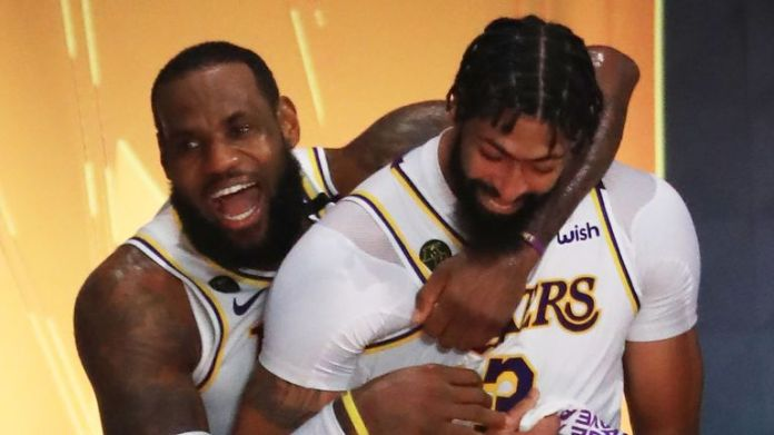 LeBron James kisses teammate Anthony Davis after leading the Lakers to a decisive win in Game 6 of the series against the Heat