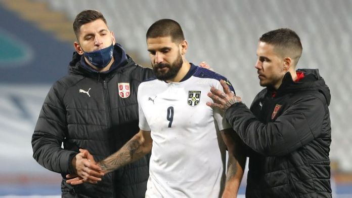 Aleksandar Mitrovic is consoled after his decisive missed penalty