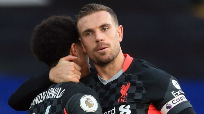 Jordan Henderson celebrates with Trent Alexander-Arnold after putting Liverpool four-up at Palace